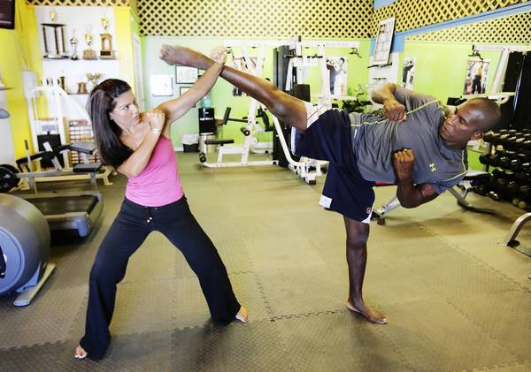 Sine and Lincoln Wallace, at Wallace Fitness in Mount Dora, are owner-operators of a gym. Lincoln is a member of the North American Martial Arts Hall of Fame, and Sine is also a black belt.