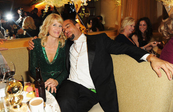 Actress Laura Dern and musician Ben Harper have finalized their divorce. Above, the couple attend HBO's Golden Globe Awards Party at Circa 55 Restaurant on Jan. 15, 2012.