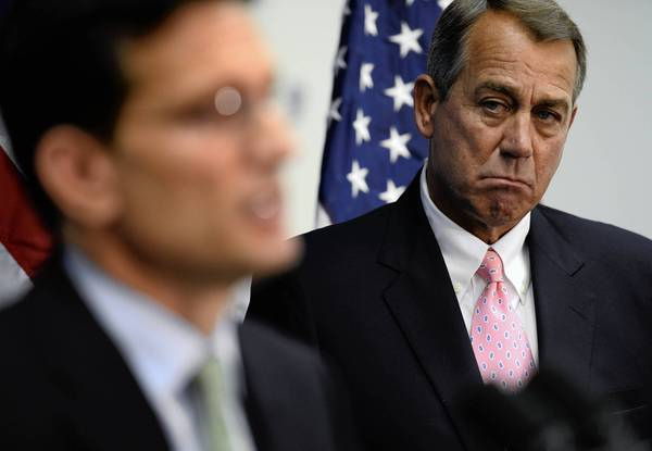 House Speaker John A. Boehner, right, listens as House Majority Leader Eric Cantor talks to reporters on Capitol Hill.