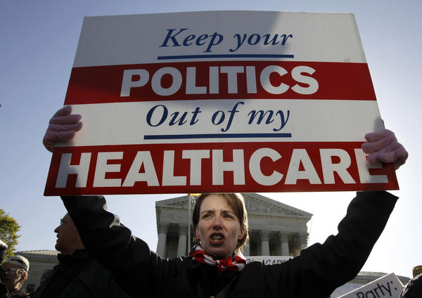 A large faction in the House wants to hold funding for the rest of the government hostage until Democrats agree to stop implementing Obamacare. Above: An opponent of the Affordable Care Act is seen demonstrating in front of the White House in 2012.