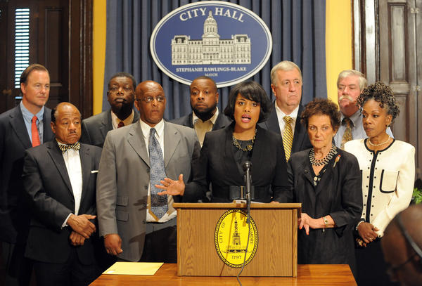 "Mayor Stephanie Rawlings-Blake held a press conference after the City Council voted to give final approval to $107 million in tax-increment-financing bonds for Harbor Point, a high-end development. Next to her at left is Bernard C. ""Jack"" Young, City Council president. At right (in black dress is City Council member Rochelle ""Rikki""v Spector. At far left in back row is Michael S. Beatty, president of Beatty Development Group, LLC."