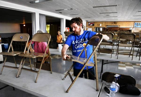 Volunteers clean up a union hall in Pueblo, Colo., that was used in state Sen. Angela Giron's unsuccessful anti-recall campaign. The National Rifle Assn. bankrolled the recall effort after she voted for gun control measures.