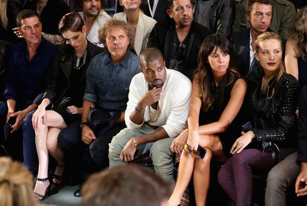 Kanye West, center, sits front row at the Diesel Black Gold show during New York Fashion Week.