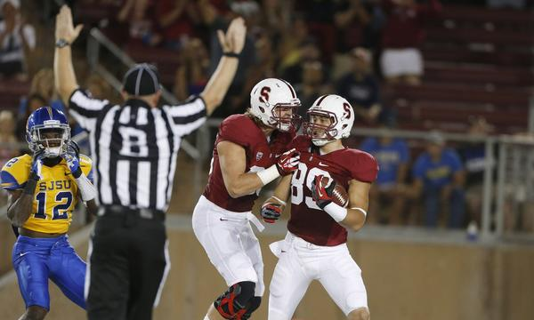 Stanford's Devon Cajuste, right, celebrates with teammate Charlie Hopkins after making a touchdown catch against San Jose State on Saturday. The Cardinal remain at the top of The Times' top 25 college football rankings.