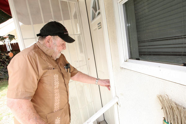 John Neilan, one of the residents at Twelve Oaks who is being forced to leave, makes his way into his apartment at the facility on Tuesday, August 27, 2013.
