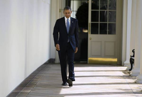 President Obama walks along the West Wing Colonnade hours before Tuesday's national address on Syria.