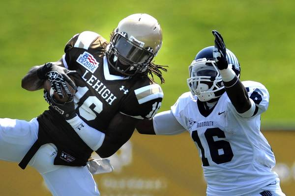 Lehigh's Rickie Hill makes an interception last season against Monmouth. Hill said he thought the defense played better as the game went on last weekend against Central Connecticut State.
