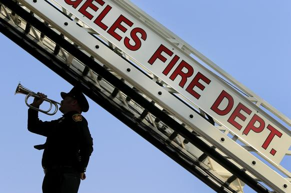 Los Angeles firefighter Dustin Clark plays taps at the end of a Sept. 11 remembrance ceremony.