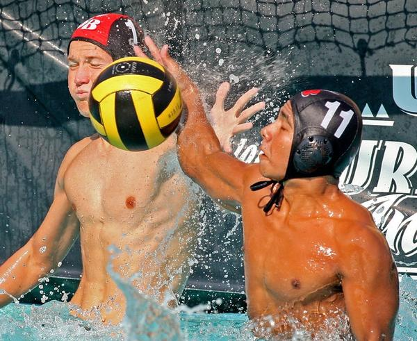 Burroughs High goalie Dillon Wiegand, left, and Oscar Hernandez team up to block a shot in a 13-4 win over Monrovia.