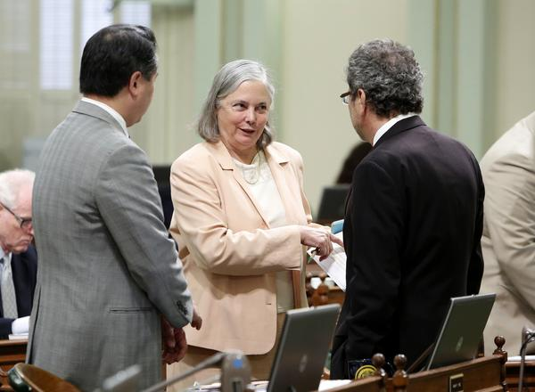 State Sen. Fran Pavley (D-Agoura Hills) talks with Assemblymen Philip Ting (D-Scotts Valley), left, and Richard Bloom (D-Santa Monica) before the Assembly voted on her fracking bill.
