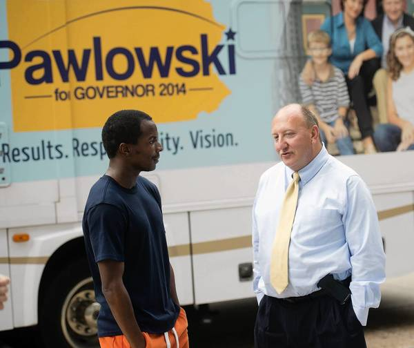 Ed Pawlowski (right), Allentown mayor and Pennsylvania gubernatorial candidate, talks to Kadeem Holmes of Philadelphia Monday during a campaign stop in the city.
