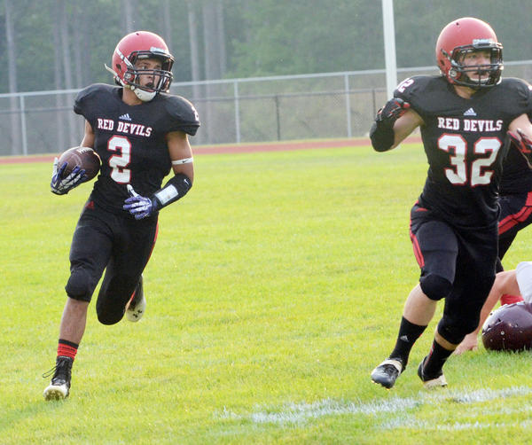 East Jordan senior running back Noah Bacchus (left) along with senior running back Tim Schut and the Red Devils take a 2-0 record into Friday's Lake Michigan Conference opener against Harbor Springs. Game time is set for 7 p.m. Friday, Sept. 13, at Boswell Stadium.