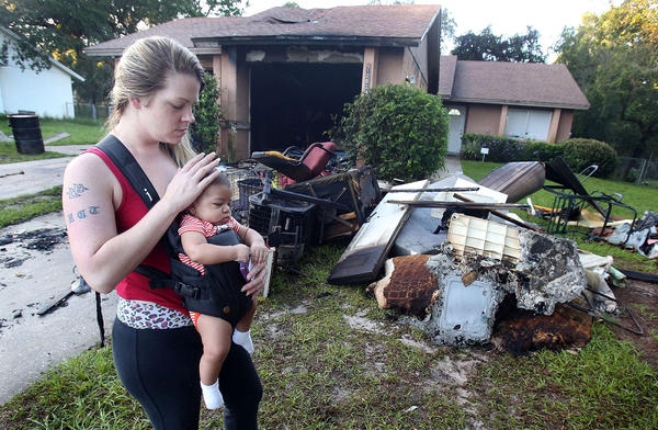 Amanda Taylor takes a moment to caress the head of her baby Keontae King, 3 months after a fire engulfed a duplex 12024 Walden Woods Drive that is connected to her families home. Taylor was up at 4:00am to feed her baby and noticed the fire and called 911.