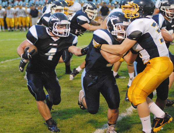 Petoskey senior running back Chase Ledingham (left) and the Northmen will face Cadillac in both teams' Big North Conference opener at 7 p.m. Friday, Sept. 13, in Cadillac. Both the Northmen and Vikings are 2-0.