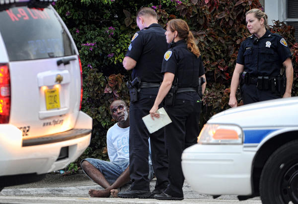 Lauderdale Police detain one of three persons after a standoff which involved the SWAT Team, Thursday, Sept. 12, 2013, on SW 4th Ave.