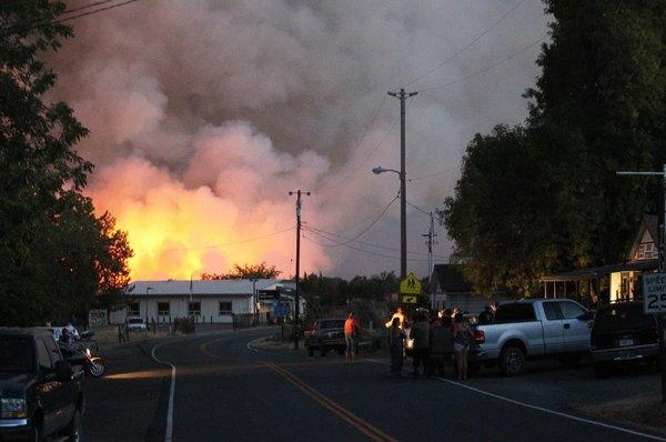 Residents gather in Igo, Calif., as the Clover fire burns near the county landfill Monday.