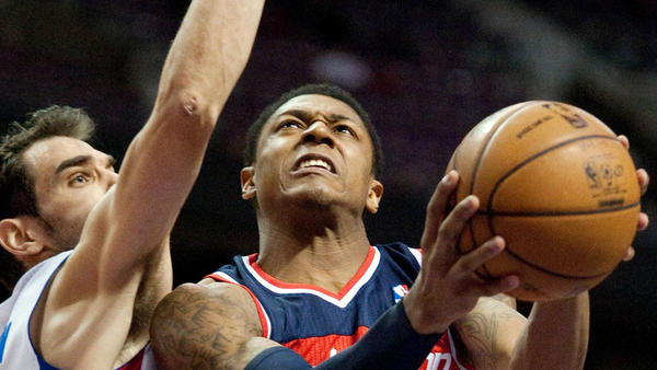 Feb 13, 2013; Auburn Hills, MI, USA; Washington Wizards shooting guard Bradley Beal (3) drives to the basket against Detroit Pistons point guard Jose Calderon (left) and center Greg Monroe (10) during the first quarter at The Palace. Mandatory Credit: Tim Fuller-USA TODAY Sports ORG XMIT: USATSI-96530