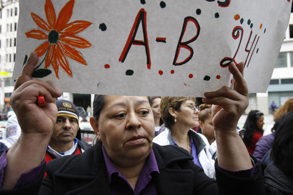 Supporters of AB 241, which would make domestic workers eligible for overtime, rally in Los Angeles in March. The bill passed the Legislature on Thursday.