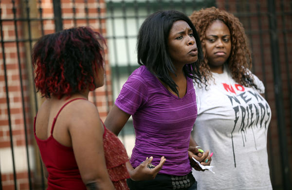 Adejoke Eko speaks with other parents after a meeting at Jordan Elementary Community School after two employees were removed for allegations of misconduct on Thursday, Sept. 12, 2013 in Chicago. (Adam Wolffbrandt/Chicago Tribune) B583190334Z.1 ....OUTSIDE TRIBUNE CO.- NO MAGS, NO SALES, NO INTERNET, NO TV, CHICAGO OUT, NO DIGITAL MANIPULATION...