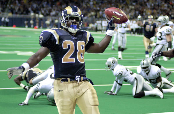 Former St. Louis Rams running back Marshall Faulk is one of dozens of present-day NFL employees to file brain injury claims against their former teams in California. Faulk works as an analyst for the NFL Network.