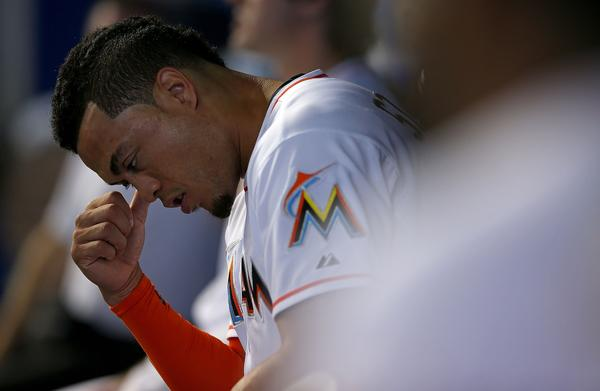 MIAMI, FL - SEPTEMBER 12: Giancarlo Stanton #27 of the Miami Marlins looks on during a game against the Atlanta Braves at Marlins Park on September 12, 2013 in Miami, Florida. (Photo by Mike Ehrmann/Getty Images) ORG XMIT: 163495502