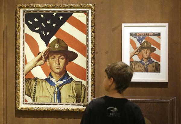 A youth looks over an exhibition in Salt Lake City of works by artist Norman Rockwell. A California bill that would remove tax-exempt status from the Boy Scouts of America for not allowing gay adult leaders was shelved Thursday.