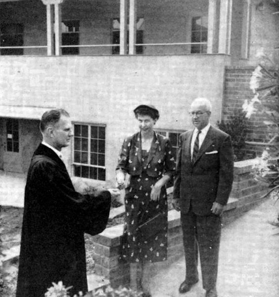 The Rev. Lawrence J. Wienert, then minister at Church of the Lighted Window, stands with Elizabeth Whitsett and William Siebert on the steps of the new church school building on the day of its dedication, Sept. 13, 1953.