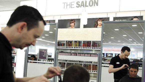 Salon Manager Robby Delulio gives Greg Shapps a haircut at the Ulta store at 16 S. Halsted St.