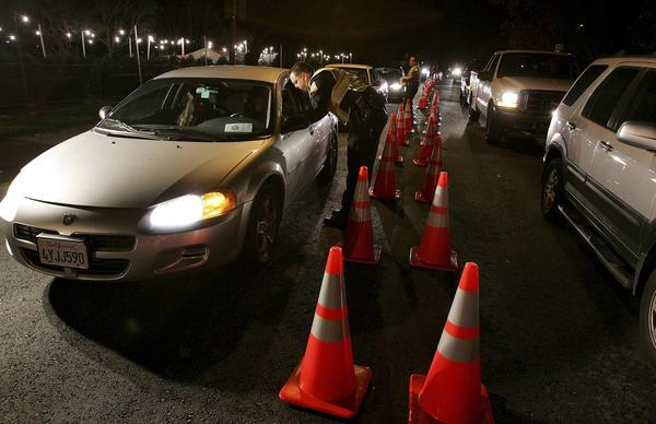 San Bruno police officers stop cars at a DUI checkpoint in 2006 in San Bruno, Calif.