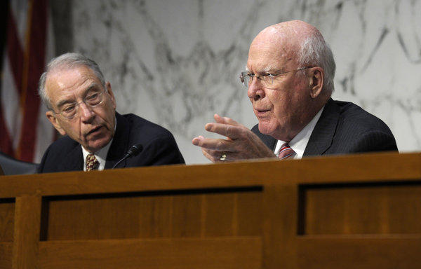 Senate Judiciary Committee Chairman Sen. Patrick Leahy (D-Vt.), left, accompanied by Republican Sen. Charles E. Grassley (R-Iowa).
