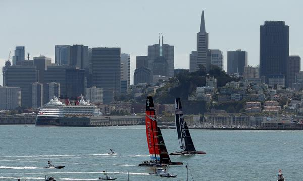 Emirates Team New Zealand, left, races against Oracle Team USA in San Francisco Bay on Thursday.