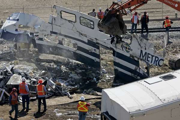 Crews remove wreckage following the September 2008 Metrolink train crash in Chatsworth that killed 25 people.
