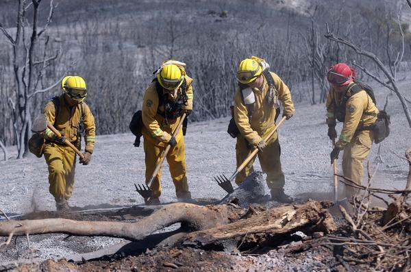 Marin County firefighters put out hot spots earlier this week in the Morgan fire in the Bay Area.