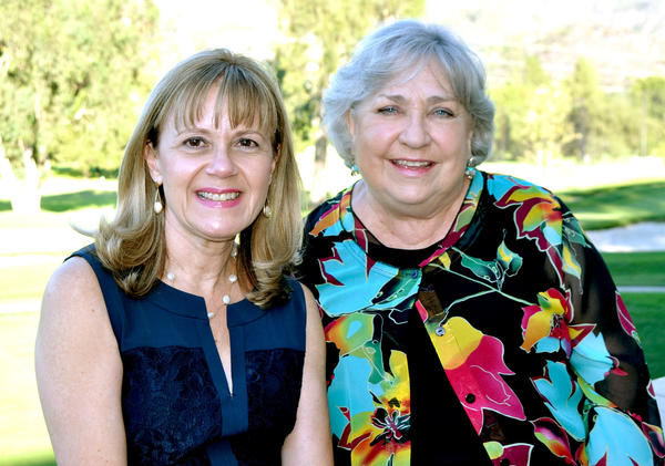 Left to right: Monica Sierra, outgoing president of Las Candelas welcomes new president Jeannie Flint.