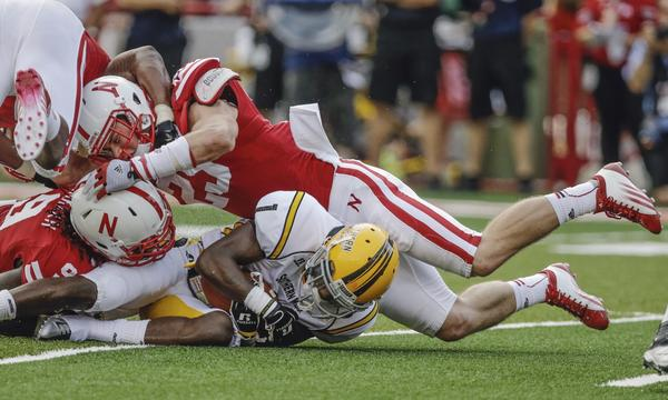 Nebraska freshman linebacker Nathan Gerry, top, and teammate Jason Ankrah tackle Southern Mississippi wide receiver Tyre'oune Holmes during the Cornhuskers' win Saturday.