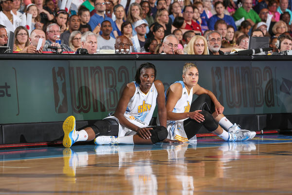 Sylvia Fowles and Elena Delle Donne wait to go in a game.