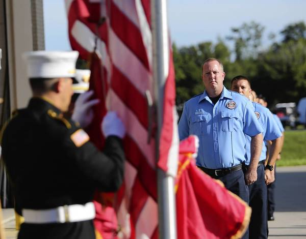 Members of the Reeedy Creek Fire Department color guard poste the Colors during a 9/11 ceremony at Lake Technical Center's Fire Academy/Institute of Public Safety in Tavares on Wednesday.
