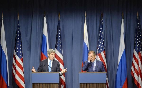 Secretary of State John F. Kerry, left, and Russian Foreign Minister Sergei Lavrov hold a news conference after their talks in Geneva.