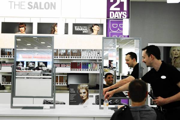 Salon manager Robby Delulio gives Greg Shapps a haircut Thursday at Ulta Beauty at 16 S. Halsted St. The company said net income climbed more than 28 percent in the second quarter ended Aug. 3, to $45 million.