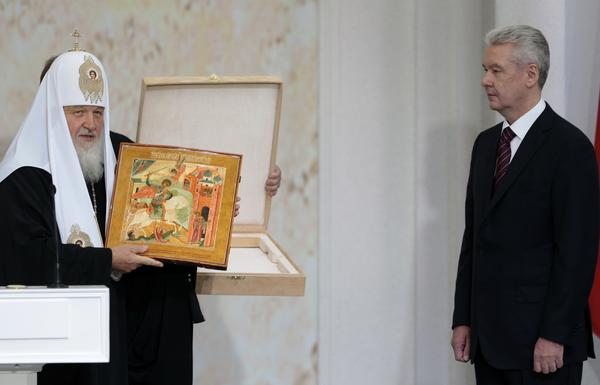 Russian Orthodox Church Patriarch Kirill, left, presents an icon depicting St. George slaying a dragon to Moscow Mayor Sergei Sobyanin at his inauguration Thursday.