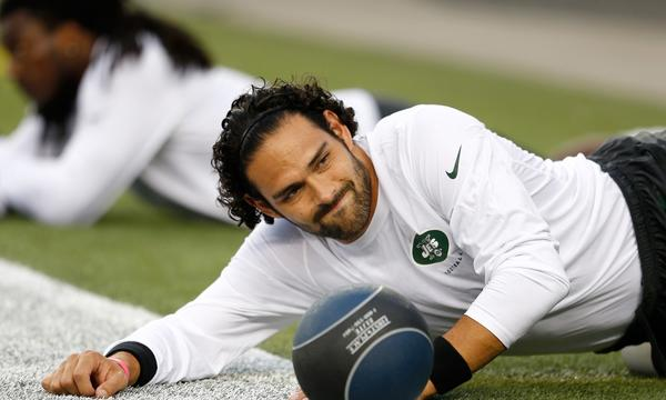 New York Jets quarterback Mark Sanchez stretches before Thursday's game against the New England Patriots.