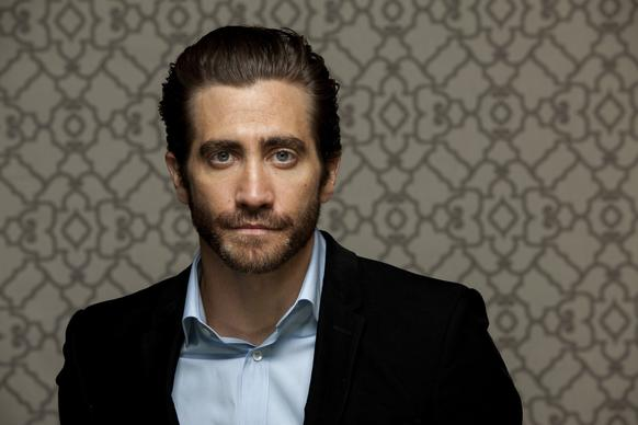 "Jake Gyllenhaal was born into Hollywood royalty. Jamie Lee Curtis is his godmother, Paul Newman is his godfather, his dad is a director and his mom is a producer-screenwriter.  Talk about connected. At the tender age of 11, little Jake made his big-screen debut in ""City Slickers."""