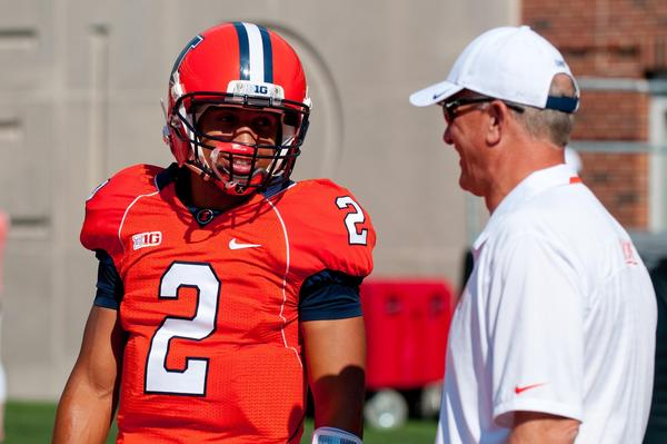Illini quarterback Nathan Scheelhaase talks with offensive coordinator Bill Cubit.