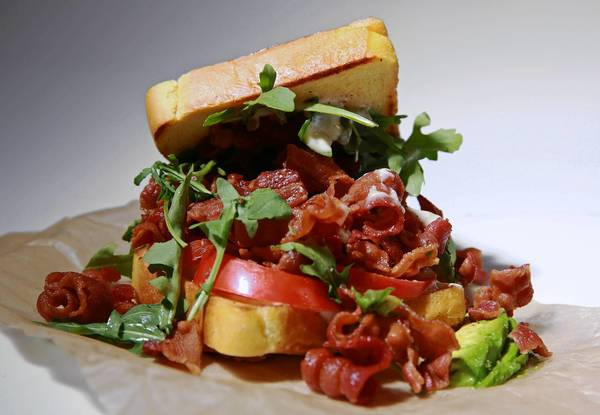The Fat Shallot food truck's BLT features bacon, arugula, tomato, avocado and truffle aioli on buttered Texas toast.