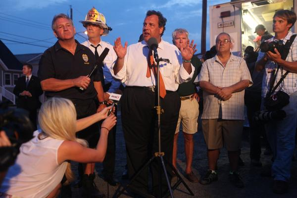 New Jersey Governor Chris Christie speaks at a news conference at the scene of a fire on the boardwalk in Seaside Heights, New Jersey, on Thursday, September 12, 2013.