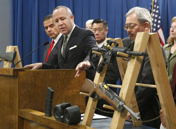 Senate President Pro Tem Darrell Steinberg, second from left, glances to a pair of semiautomatic rifles as he discusses a package of proposed gun control legislation earlier this year.