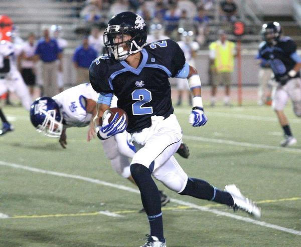 Crescenta Valley High's Connor Van Ginkel carries the ball down field for a long gain in the first quarter against San Marino in a nonleague football game at Glendale High2013. (Tim Berger/Staff Photographer)