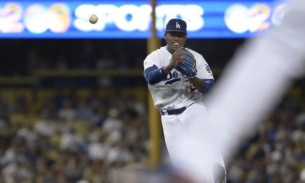 Dodgers shortstop Hanley Ramirez makes a throw to first base during the seventh inning of the Dodgers' 3-2 win over the San Francisco Giants on Thursday.