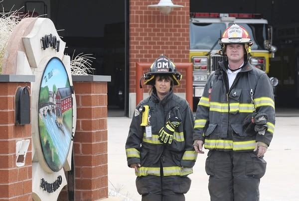 Marci Catlett, vice president, and Capt. Eddie Schwartz stand in front of the Owings Mills Volunteer Fire Company station in Owings Mills. The volunteers have been overwhelmed by non-emergency calls from the nearby Weinberg Center.