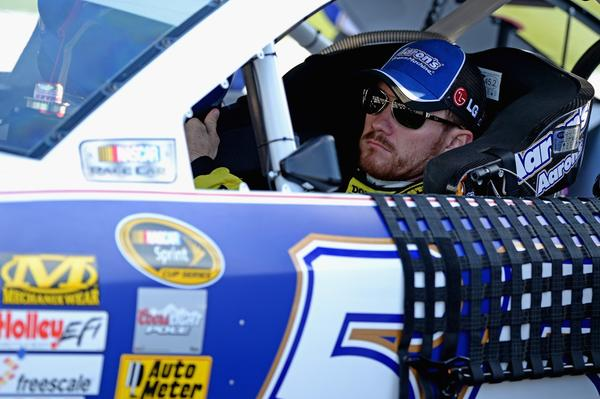 Brian Vickers sits in his car during qualifying for the NASCAR Sprint Cup Series Federated Auto Parts 400 at Richmond (Va.) International Raceway.